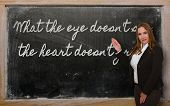 Teacher Showing What The Eye Doesn T See, The Heart Doesn T Grieve On Blackboard