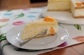 image of tort  - Torte with cream,  curd, manderines and fork