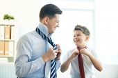 picture of schoolboys  - Photo of happy boy and his father tying neckties - JPG