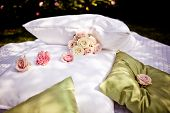 Blanket and pillows decorated with roses