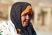 SAHARA DESERT, MOROCCO 19 OCTOBER 2013: Old nomad woman in the Sahara desert, Morocco. Nomadic tribe
