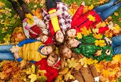 Kids Lay On The Autumn Grass