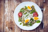 pic of egg noodles  - Dietary green pasta with vegetables spinach leaves egg parmesan cheese and cherry tomatoes in a white plate on a wooden table fresh rural lunch in a rustic style - JPG