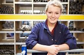 Portrait Of Female Engineering Apprentice In Store Room