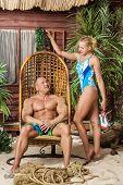 Beautiful athletic couple on the sandy beach