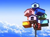 picture of nesting box  - Colorful nesting boxes on blue sky - JPG