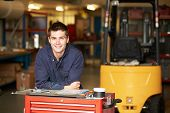 image of lift truck  - Portrait Of Apprentice Engineer In Factory - JPG