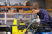 stock photo of bender  - Factory Engineer Operating Hydraulic Tube Bender - JPG