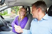 Teenage Girl Passing Driving Test With Examiner