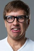 image of crazy face  - Man makes lots of crazy face emotions - JPG