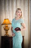 foto of lace-curtain  - Young beautiful luxurious woman in long elegant dress - JPG