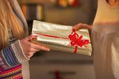 Closeup On Two Girlfriends Exchanging Christmas Presents