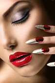 Fashion Beauty Model Girl. Manicure and Make-up. Nail art. Beautiful Woman With Red Nails and Luxury Makeup. Beautiful Girl Face and Hand close-up. Perfect Skin
