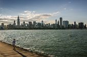 People Running In Chicago During Sunset