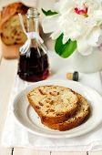 Slices Of Bergamot Tea Cake, A Bottle Of Creme De Cassis And A Peony Flower