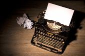 stock photo of outdated  - Vintage typewriter and a blank sheet of paper - JPG