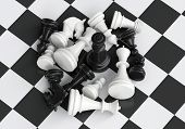 Black chess king in the midst of battle