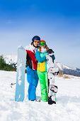 Smiling couple in ski masks standing together