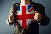 Man Stretching Jacket To Reveal Shirt With Great Britain Flag