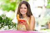 Beautiful woman having an aperitif outdoor