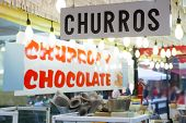 Churros and chocolate fritter typical food in Valencia Fallas fest at spain