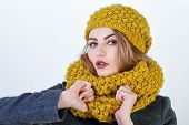 pic of cold-shoulder  - Young attractive Frenchwoman in knitted hat and scarf isolated on white background - JPG