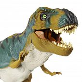 Closeup image of an opened mouth Tyrannosaurus rex on a white background.