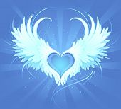 stock photo of blue angels  - Blue heart of an angel with painted beautiful white wings on a blue background radiant - JPG