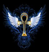 foto of ankh  - gold ankh with white wings on a dark blue patterned background - JPG