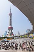 SHANGHAI, CHINA - APRIL 10, 2014: View of The Oriental Pearl Radio and TV Tower and Shanghai Lujiazu