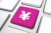 Close-up of pink yen currency sign on a keyboard button.