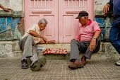 Two  men playing checkers