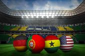 Composite image of footballs in group g colours for against large football stadium with brasilian fans