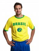 Attractive Guy With Brazilian Jersey Smiling At Camera