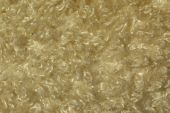 stock photo of villi  - gold wool texture fabric background with visible villi - JPG