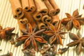 image of ouzo  - Anise star cinnamon sticks and cloves on bamboo background - JPG