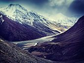 Vintage retro effect filtered hipster style travel image of severe mountains - Spiti valley, river,