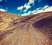 Vintage retro effect filtered hipster style travel image of dirt road in mountains (Himalayas). Spit