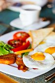 Delicious breakfast with fried eggs, vegetables and toast