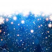 Winter blue background. Fallen defocused snowflakes. Christmas. Vector.