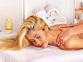 Blond beautiful woman getting massage.