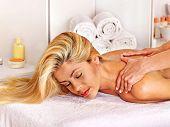 Blond beautiful woman getting massage.