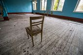 image of nuclear disaster  - Wooden chair in one of the buildings of Chernobyl - JPG