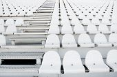 foto of grandstand  - Empty white stadium seats on grandstandof the football stadium - JPG