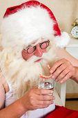 Morning ritual of Santa Claus, putting his false teeth in