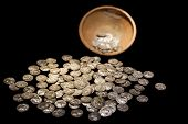 Old antique brown treasure pot with ancient gold and silver coins money black isolated