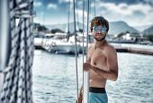 Sexy man on sailboat, relaxation in luxury sea cruise, summertime leisure time on water transport, freedom and enjoyment concept