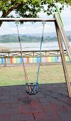 Solitaire swing in a playground on the spain coast