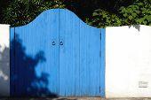 Old wooden blue gateway