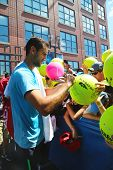 Professional tennis player Marin Cilici signing autographs after practice for US Open 2014